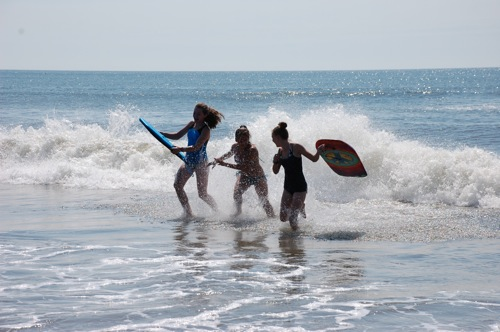 Cousins in surf.